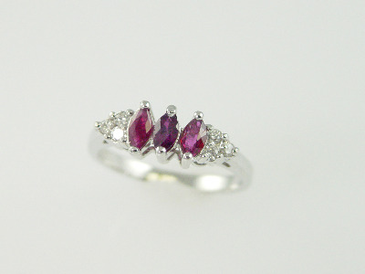 14KT White Gold Marquise Rubies 0.58ct and Round Diamonds 0.15ct Ring