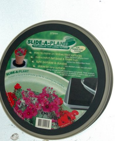"""Slide-a-plant - New -13 3/4 """"across - smooth for carpeted floors"""