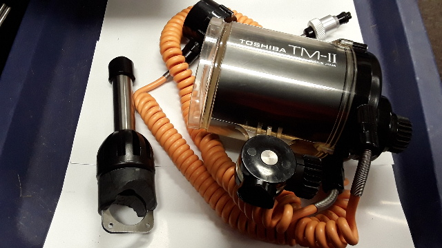 Toshiba TM-II Underwater Flash W/cords but has a broken bracket.