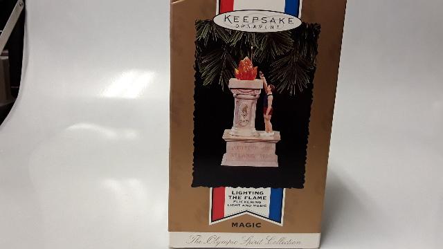 Hallmark Keepsake Ornament Lighting The Flame 1996 Light and Music.