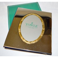 Towle Silversmiths Silver finish photo album w/14 pages of 4 slots for pictures and 1 on the front.