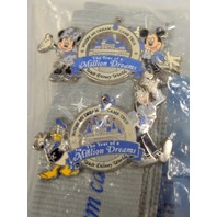 "Disney Lanyard and Two Pins - New ""Where my dreams came true"" written on it."
