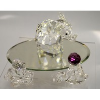Crystal Creatures: Elephane, Bear with Ball, Octopus with ball sitting on a mirror.