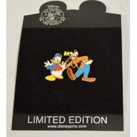 "Disney  LE250 #98025 Goofy putting ""kick me"" sign on Donald."