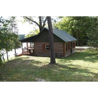 Rustic Log Cabin Home located on Beautiful Thunder Bay River w/ View & Frontage