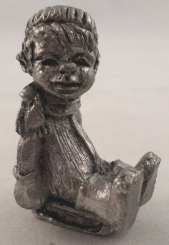 Pewter Collectible Figurine Little Boy On A Sled Winter Hat And Coat