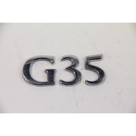 Infiniti G35 Coupe Emblem Logo for Trunk Deck Luggage Lid 84894-AM800 OEM 03-07